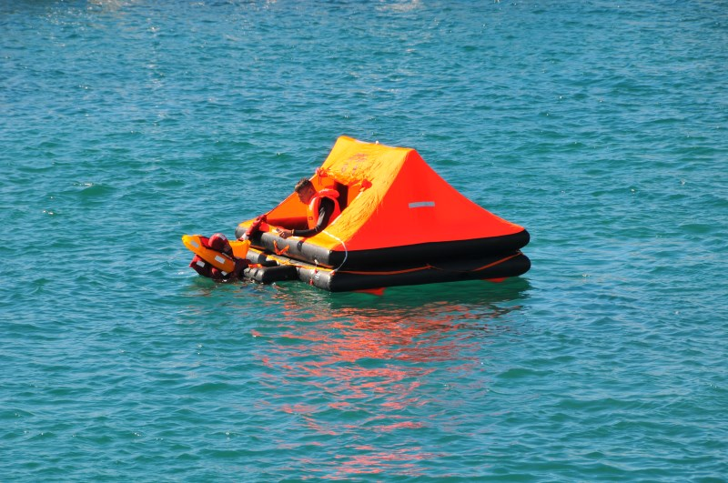 Yacht-Pool Safety at Sea entering life raft at 17th BBS 2015.